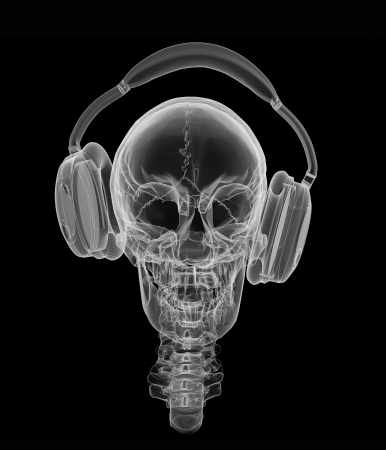 Human skull in headphones isolated on a black background with xray effect photo