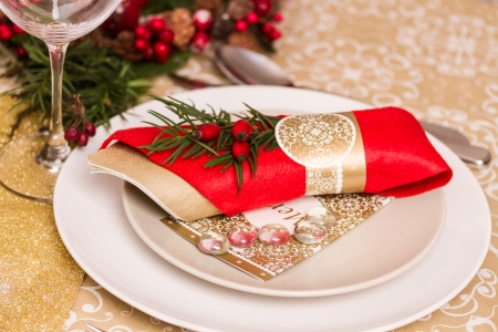 Beautifully set table in red and gold for Christmas Eve Stock Photo
