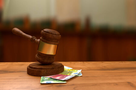 Stacks of money and judges gavel on wooden table Stock Photo