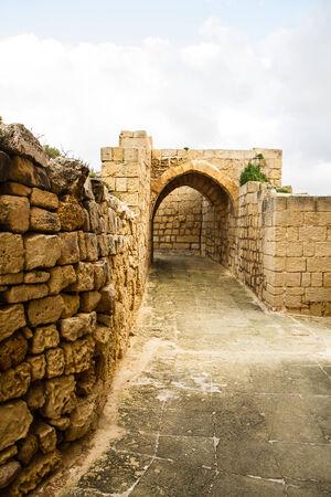 citadel: Narrow medieval street in the citadel of Gozo, Malta Stock Photo