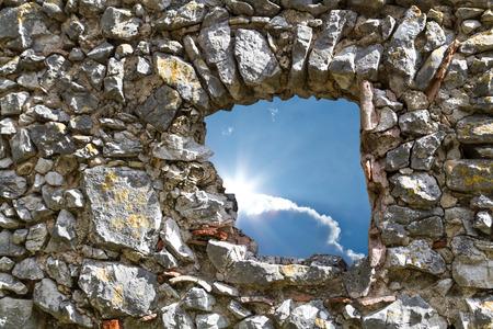 stonemasonry: View through a stone wall window to the sky
