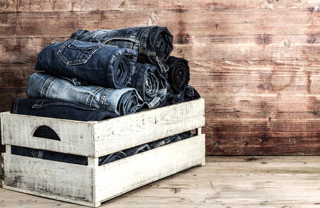 jeans over old grungy wood planks background