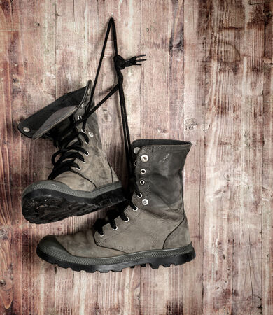 hiking shoes: rugged shoes over old grungy wood planks background