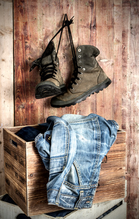 rugged: rugged shoes and jeans over old grungy wood planks background Stock Photo