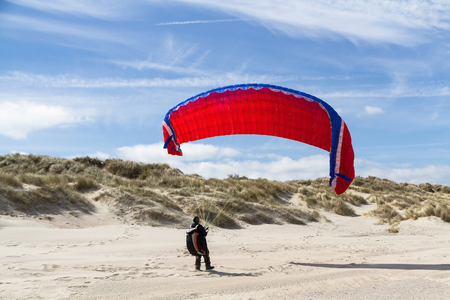 hang glider: Paragliding beach activity Stock Photo