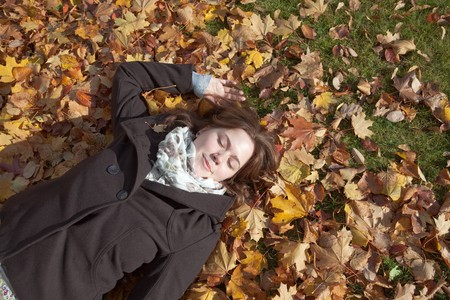 Relaxing in the leaves during autumn Stock Photo - 7514247