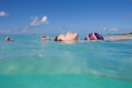A young woman in a bikini floating on water Stock Photo - 7526987