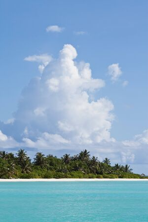 Impressive cloud above a maldivian island photo