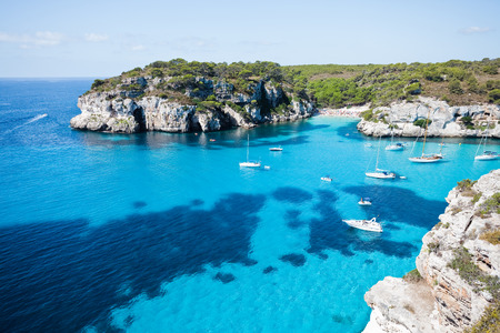 Blue water of Minorca Spain Stock Photo