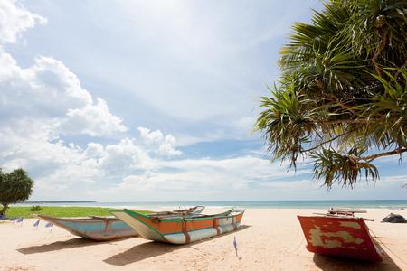 Asia - Sri Lanka - Ahungalla - Traditional longboats at the beach