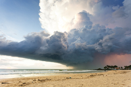 Ahungalla Beach, Sri Lanka, Asia - A gigantic storm cloud above the beach of Ahungalla