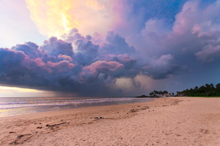 Ahungalla Beach, Sri Lanka, Asia - Colorful clouds and light during sunset at the beach of Ahungalla Stock Photo