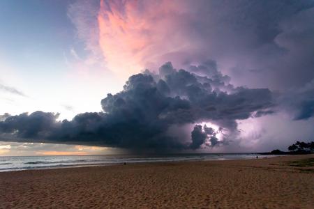 Ahungalla Beach, Sri Lanka, Asia - Thunder and lightning during sunset at the beach of Ahungalla 스톡 콘텐츠