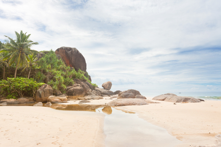 Bentota, Sri Lanka, Asia - A small river in front of huge granite rocks and palm trees Standard-Bild - 96923004