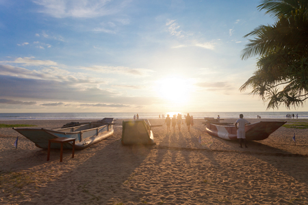 Ahungalla, Sri Lanka, Asia - Traditional longboats at Ahungalla Beach during sundown Standard-Bild - 96923009