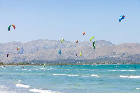 Alcudia, Mallorca, Spain - A sky full of kites at the farsighted beach of Alcudia