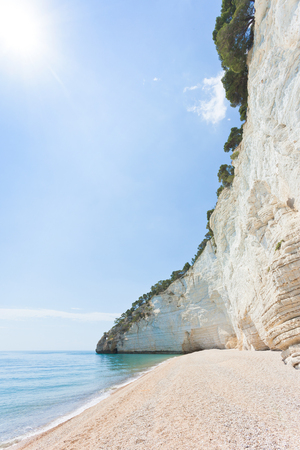 Vignanotica, Apulia, Italy - High noon at the gravel beach of Vignanotica Standard-Bild - 101336146