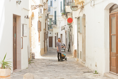 Gallipoli, Apulia, Italy - Cobblestone in the middle aged alleyways of Gallipoli Standard-Bild - 101520269