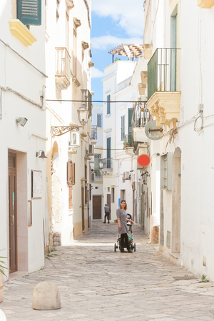 Gallipoli, Apulia, Italy - Lovely view into a traditional lane of Gallipoli Standard-Bild - 101535360