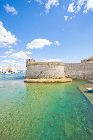 Gallipoli, Apulia, Italy - View across the turquoise water towards the middle aged stronghold Stock Photo