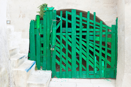 Leuca, Apulia, Italy - An old handmade green folding gate in a fortress Standard-Bild - 101699103