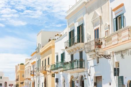 Gallipoli, Apulia, Italy - Middle aged facades with balconies in a wonderful alleyway Standard-Bild - 101711369