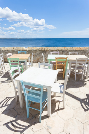 Gallipoli, Apulia, Italy - Out for lunch in the sun at the middle aged promenade Standard-Bild - 101522896