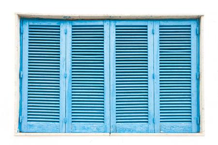 Leuca, Apulia, Italy - A traditonal blue closed lamella window Standard-Bild - 101699203