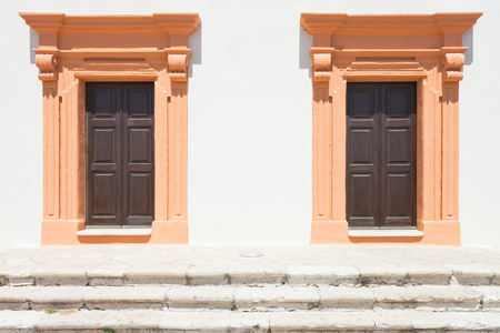 Gallipoli, Apulia, Italy - Two salmon middle aged barn doors Standard-Bild - 101521138