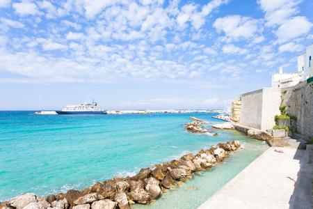 Otranto, Apulia, Italy - Sunbathing at the quay of Otranto in Italy