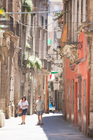 Taranto, Apulia, Italy - MAY 31, 2017 - A tourist couple walking through an alleyway of Taranto Editorial