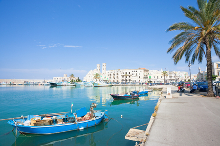 Molfetta, Apulia, Italy - JUNE 3, 2017 - Traditional fishing boats at the harbor promenade of Molfetta