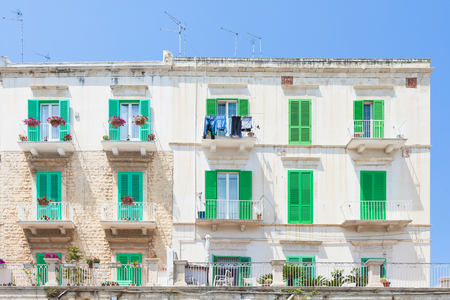 Molfetta, Apulia, Italy - Green window shutters at the historical facades in Molfetta