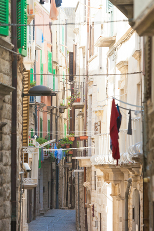 Molfetta, Apulia, Italy - Narrowness lifestyle in the old alleyways of Molfetta Editorial