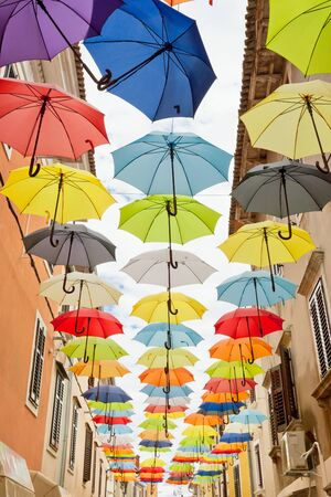Novigrad, Istria, Croatia, Europe - Colorful umbrellas tied in line to celebrate freedom Standard-Bild