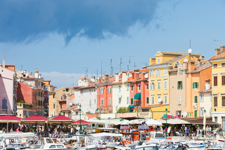 Rovinj, Croatia, Europe - SEPTEMBER 2, 2017 - Tourists, boats and restaurants at the harbour of Rovinj Editorial