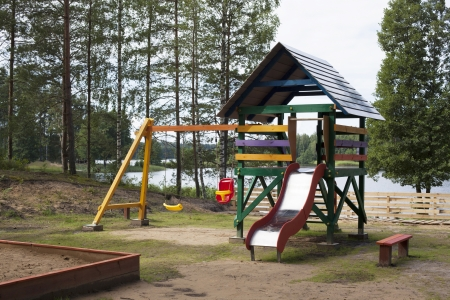 Playground without children on lake photo