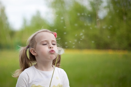 southern european descent: the girl with a dandelion outdoor