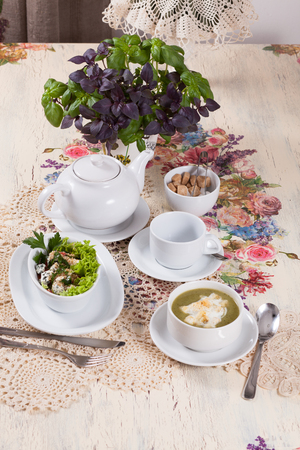 beautifully served table in vintage style with lunch - tea, soup and salad photo