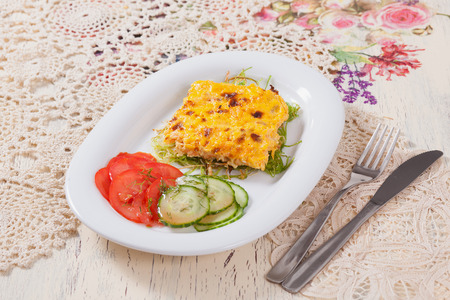fish with cheese sauce and vegetables Serving Table photo