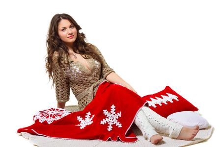 beautiful long-haired girl with a Christmas blanket and pillow