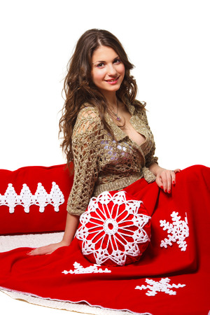 whitw: beautiful long-haired girl with a Christmas blanket and pillow