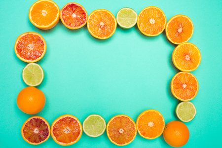 Frame from slices of orange and citrus. Space for text. Top view.