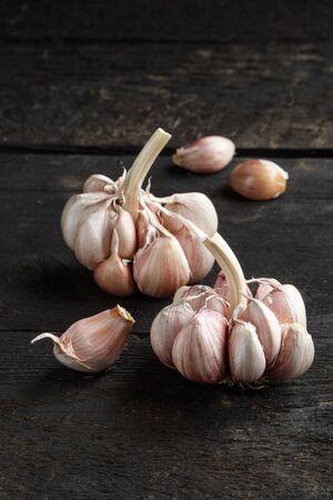 Garlic, Garlic cloves and Garlic bulb in vintage handmade wooden dark table.