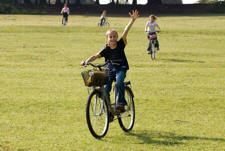 Mother and three children are riding bikes cross country photo
