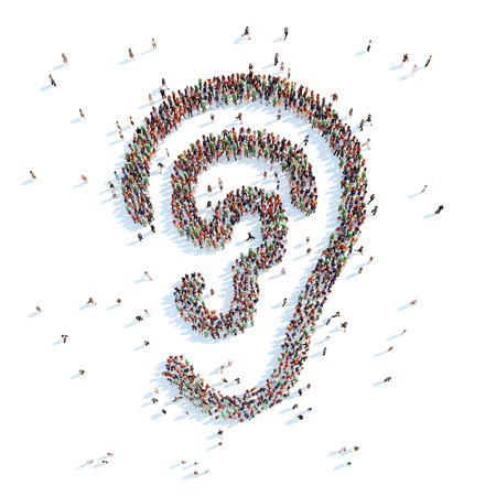 Een grote groep mensen in de vorm van je oor. Witte achtergrond. Stockfoto
