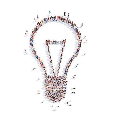 Een grote groep mensen in de vorm van de lamp en ideeën. Geïsoleerde, witte achtergrond. Stockfoto