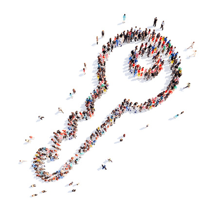 A large group of people in the shape of a key. Isolated, white background.