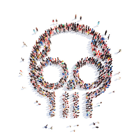 large skull: A large group of people in the shape of a skull. Isolated, white background. Stock Photo
