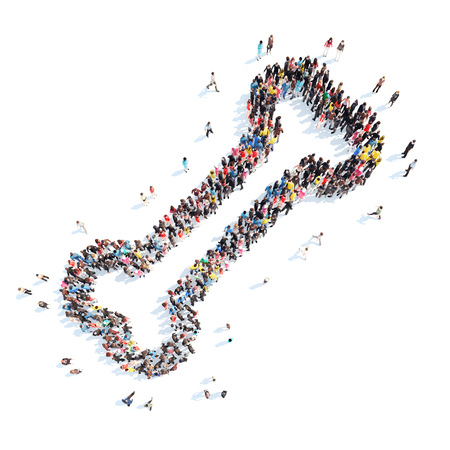 A large group of people in the shape of a bone. Isolated, white background. photo